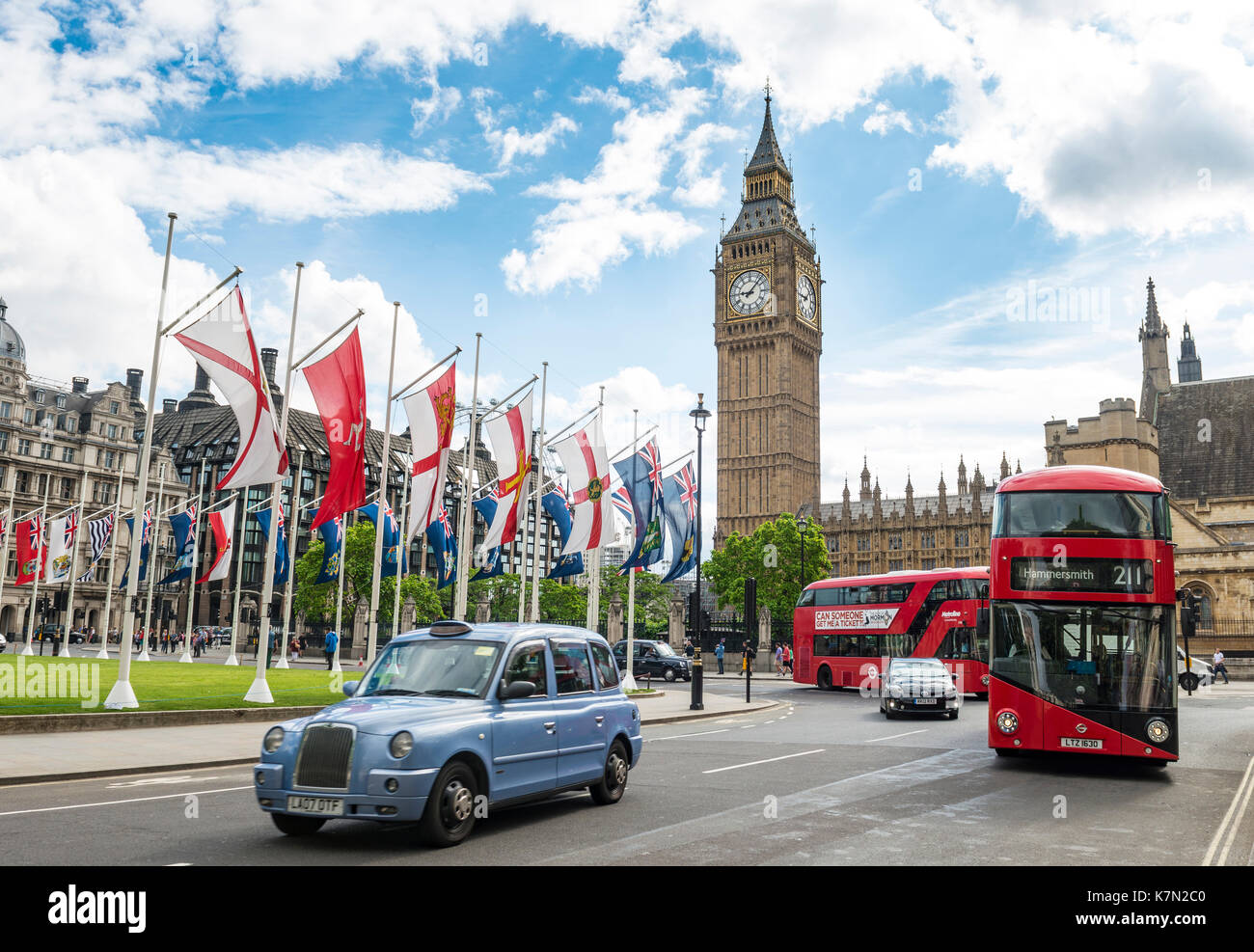 Taxi and red double-decker bus, Big Ben with Westminster Palace, London, England, Great Britain - Stock Image