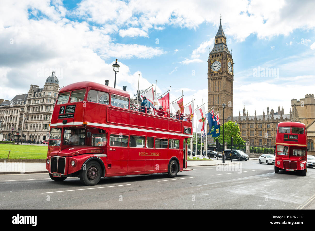 Red double-decker buses, Big Ben with Westminster Palace, London, England, Great Britain - Stock Image
