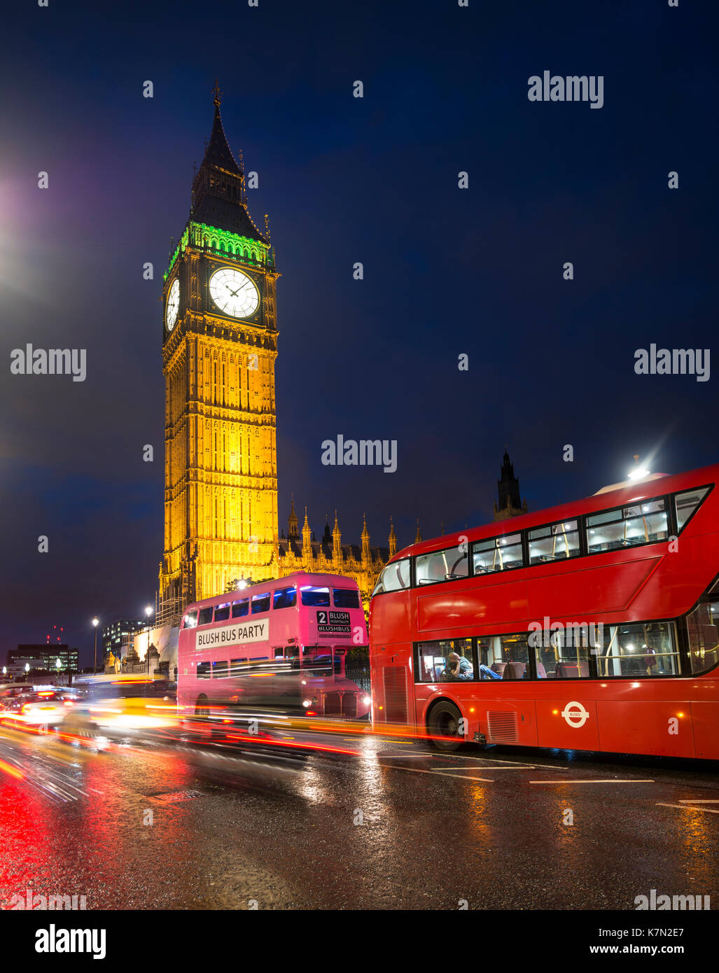 Red double-decker buses in front of Big Ben, Houses of Parliament, light tracks, night scene, City of Westminster, London - Stock Image