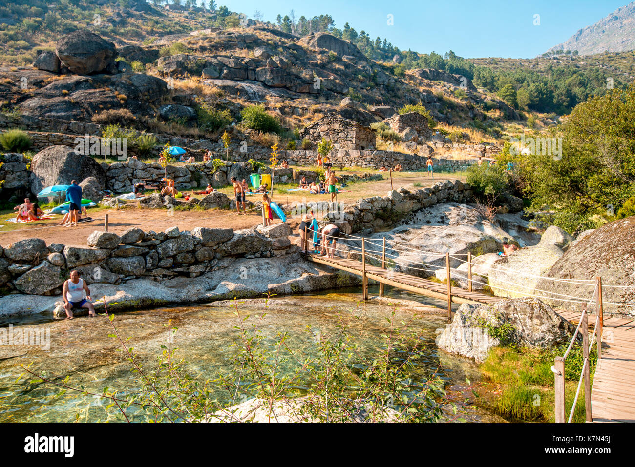 People enjoy the day in the river beach - Stock Image