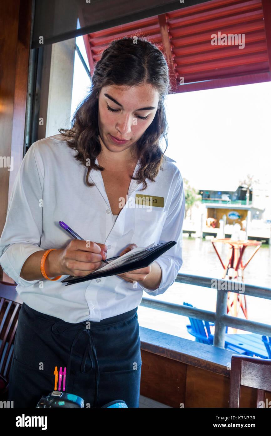 South Carolina SC Mt. Pleasant Shem Creek waterfront R.B.'s Seafood Restaurant dining woman waitress job writing order - Stock Image
