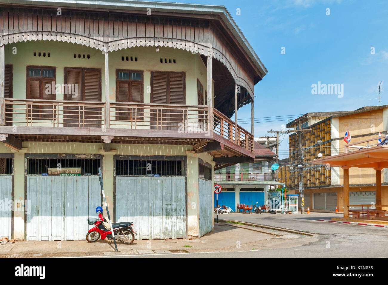 Nakhon Phanom, Thailand - May 2017: Conserved old mixed concrete and wooden shophouse in downtown Nakhon Phanom, Thailand - Stock Image