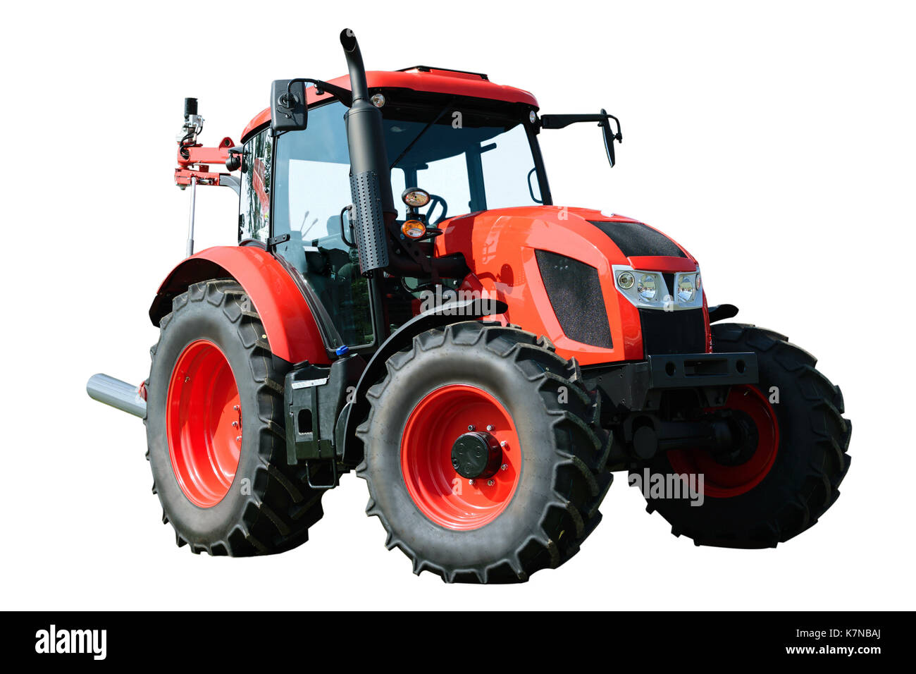 New and modern red agricultural generic tractor isolated on white background. May depict third Party IP. - Stock Image