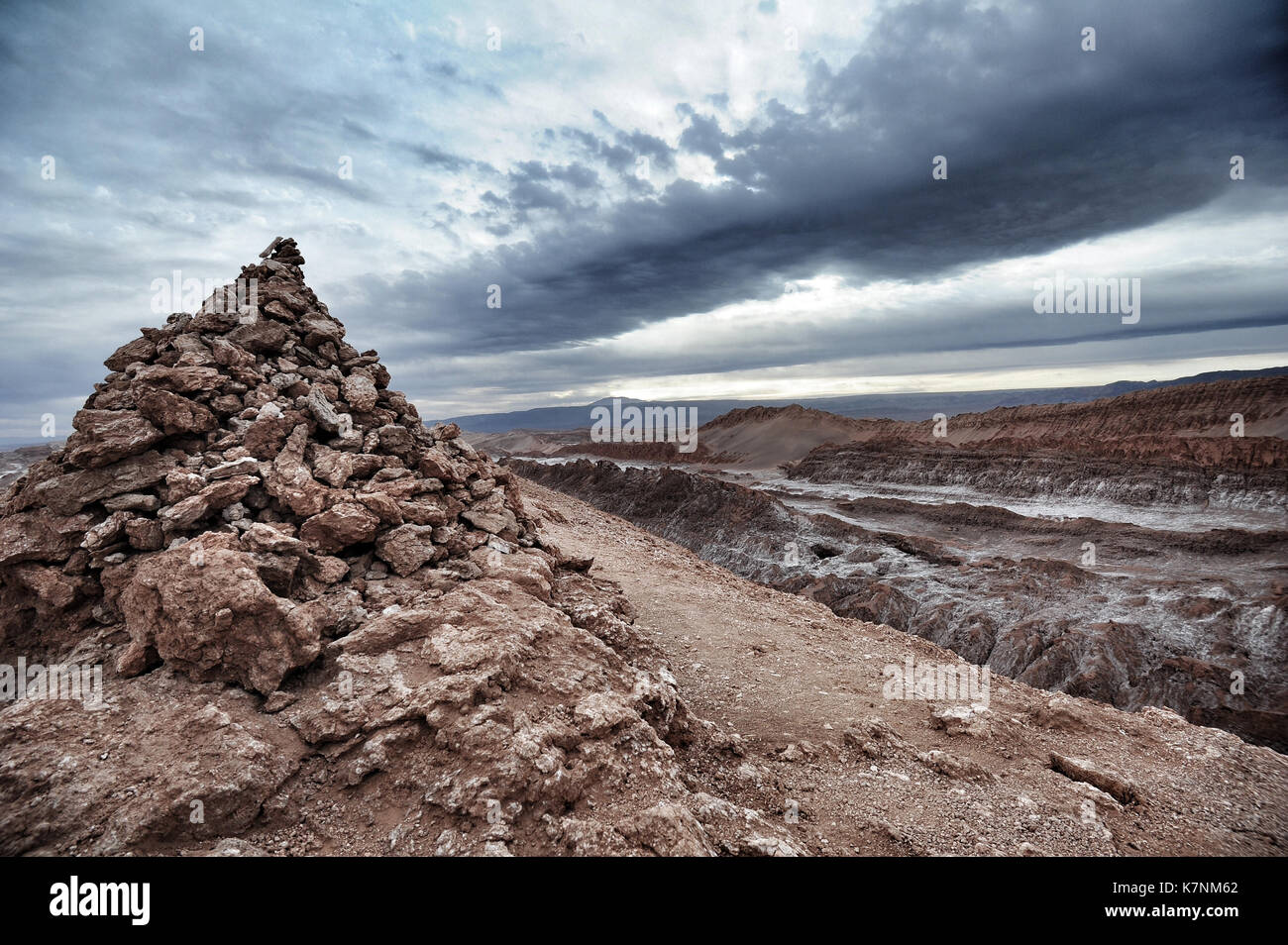 A human-made pile of stones in the Valle de la Luna, in the Atacama region, Northern Chile - Stock Image