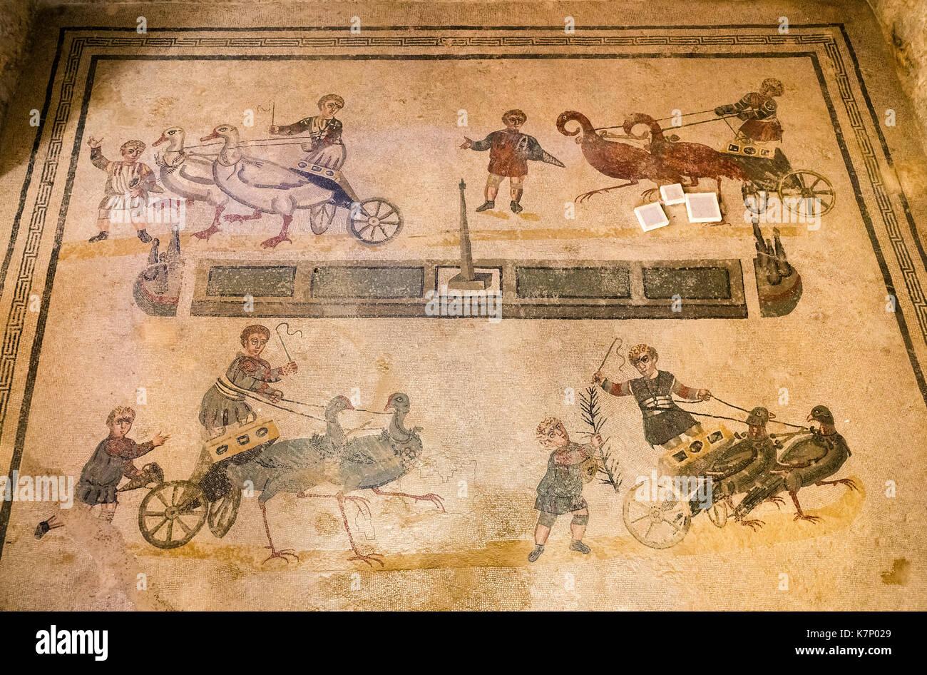 Pram races, antique Roman floor mosaic, Villa Casale, Villa Romana del Casale, Piazza Armerina, Sicily, Italy - Stock Image