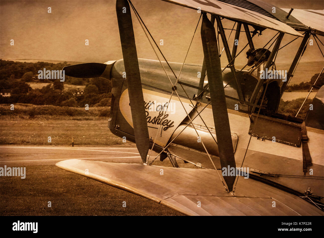 Sepia image of a De Havilland DH82A Tiger Moth on an airfield - Stock Image