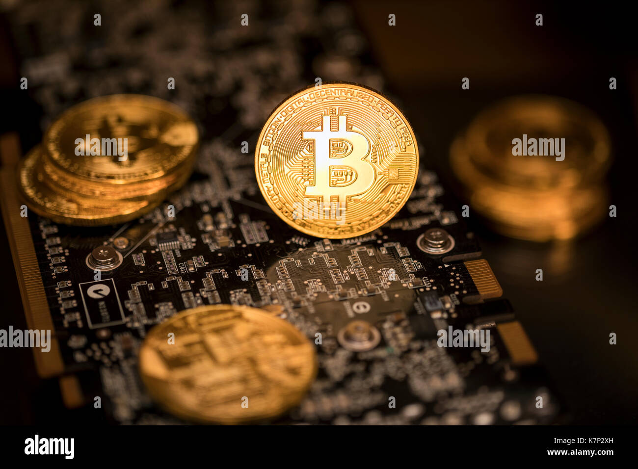 View of a stack of bitcoins on background of electronick schemes - blockchain and cyber currency concept - Stock Image
