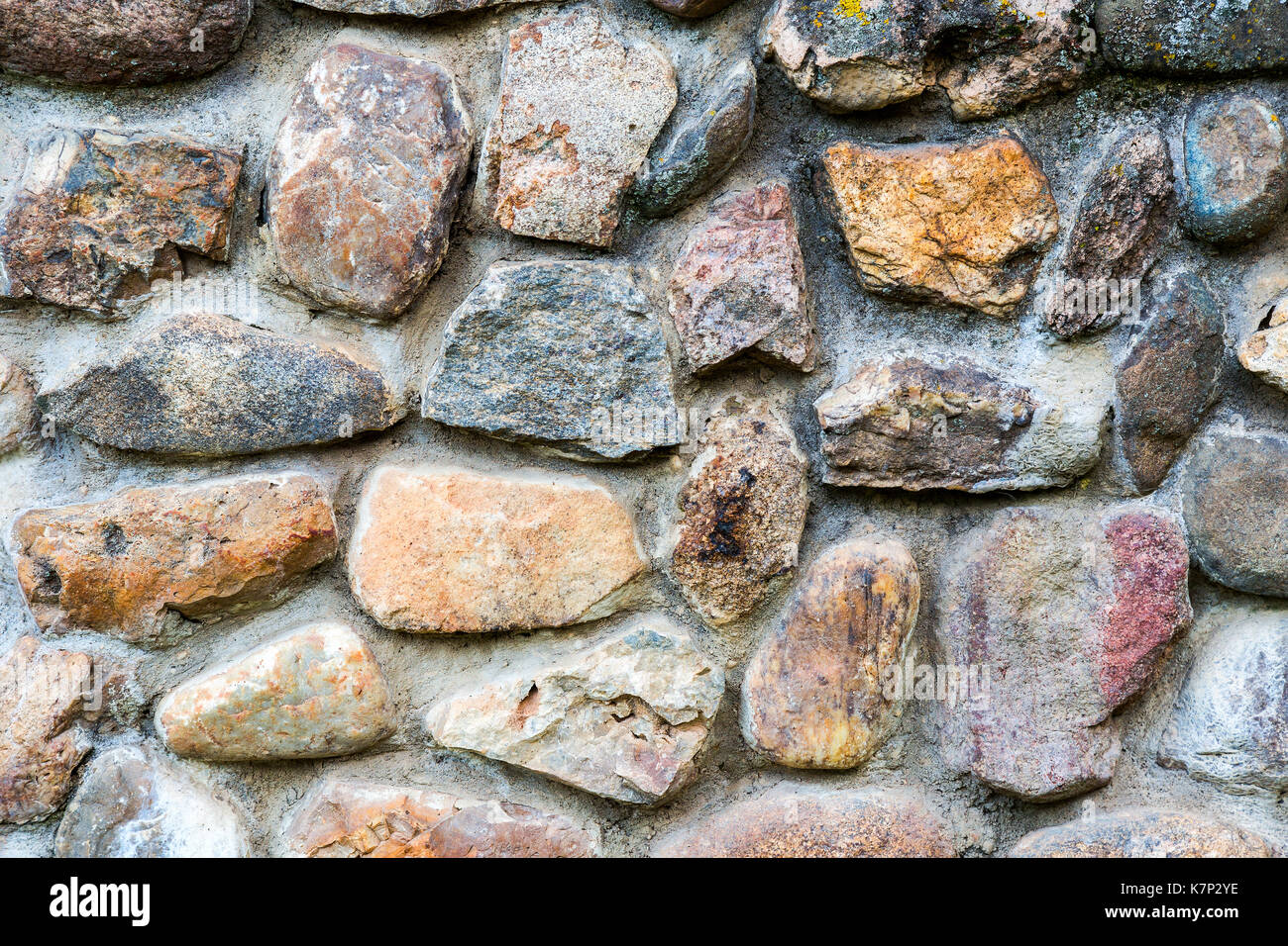 Background texture of an old stone wall - Stock Image