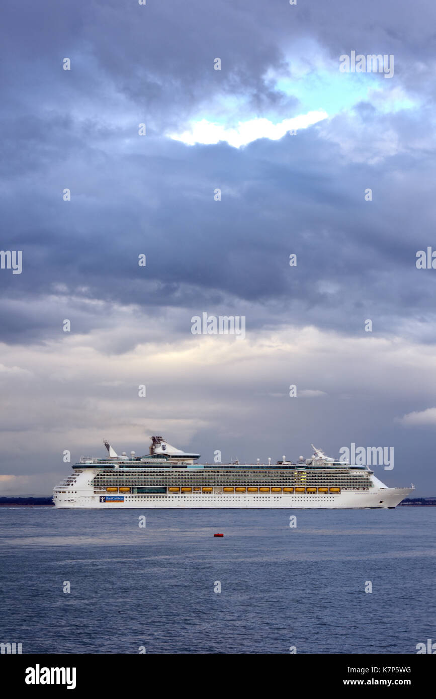 royal Caribbean cruise ship independence of the seas leaving the port of Southampton docks and rounding calshot spit into the thorn channel solent. - Stock Image