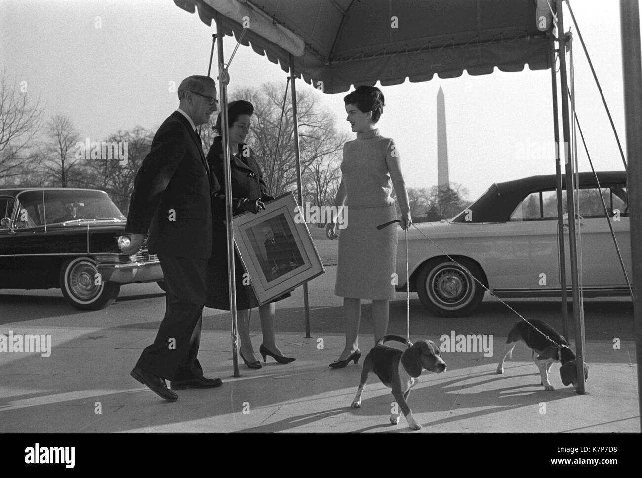 Lady Bird Johnson (center) and her daughter Luci Baines Johnson, holding the leashes of the family dogs (right), Stock Photo