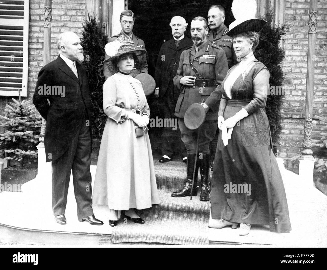 French President Raymond Poincare and wife (left) meet with King George V and Queen Mary of England, the young Prince Stock Photo