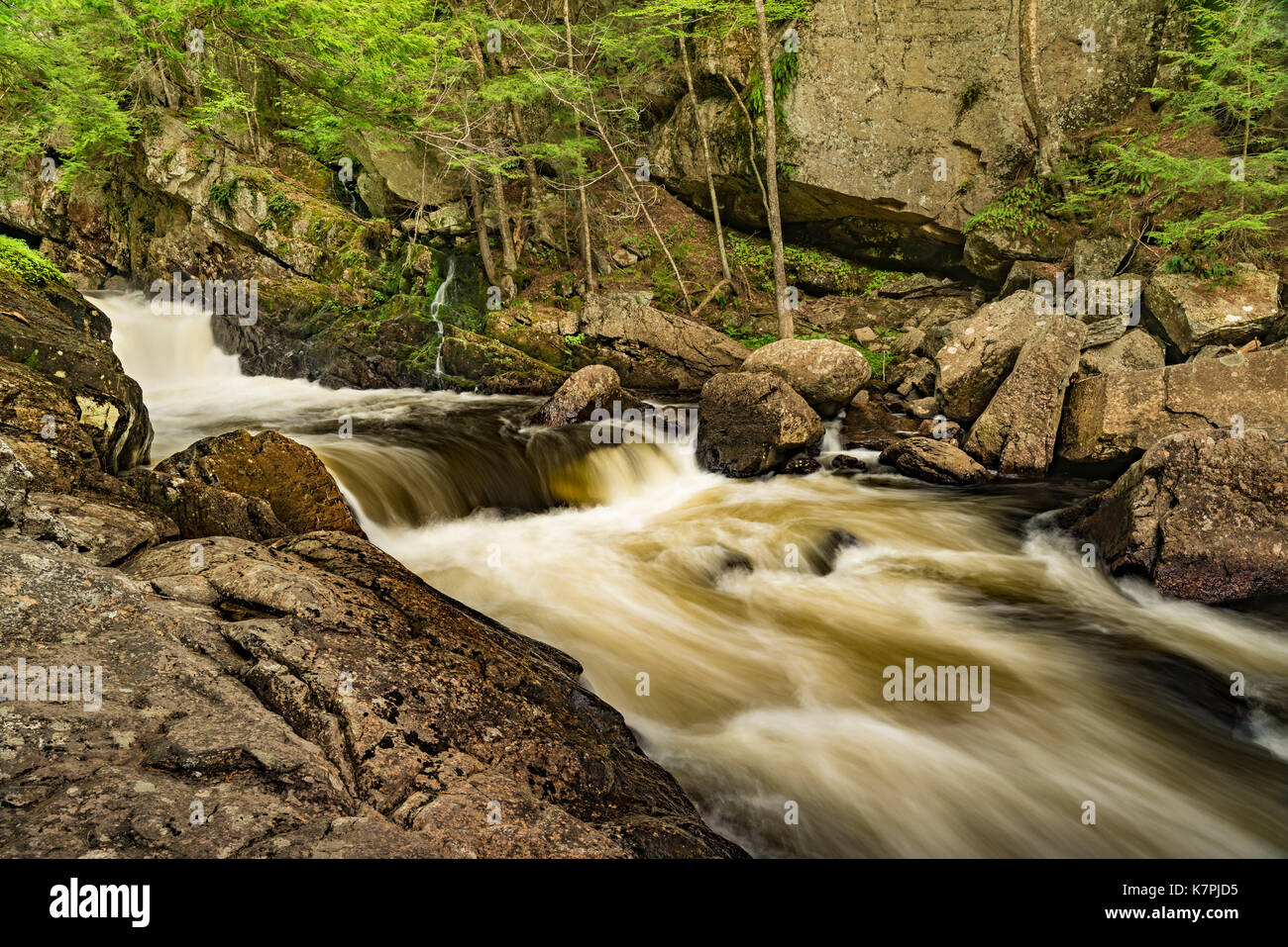 Fast moving rapids on the Sacandaga Riiver as it passes by a narrow gorge, Adirondack Park, Hamilton County, NY - Stock Image