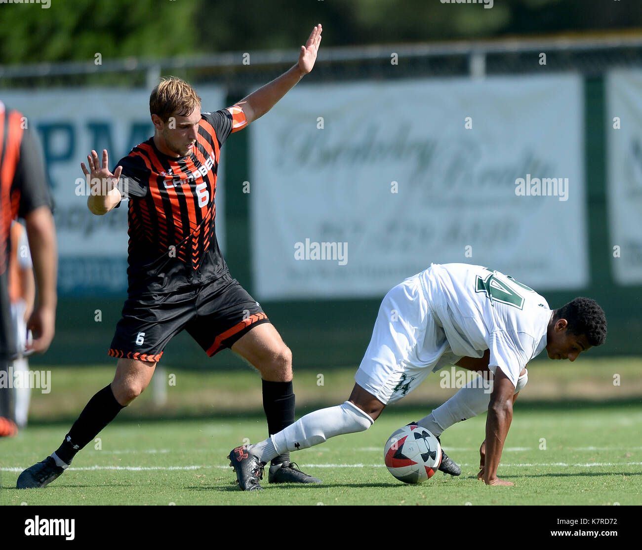 Williamsburg, VA, USA. 16th Sep, 2017. 20170916 - Campbell midfielder GIDEON BETZ (6) trips William and Mary midfielder JULIAN NGOH (24) in the second half at Martin Family Stadium in Williamsburg, Va. Credit: Chuck Myers/ZUMA Wire/Alamy Live News - Stock Image