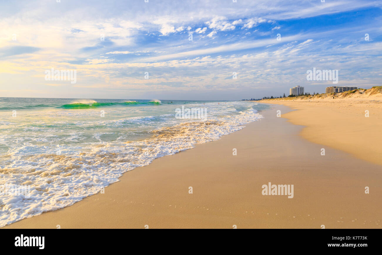 A wave breaking on the shores of Scarborough Beach. Perth, Australia - Stock Image