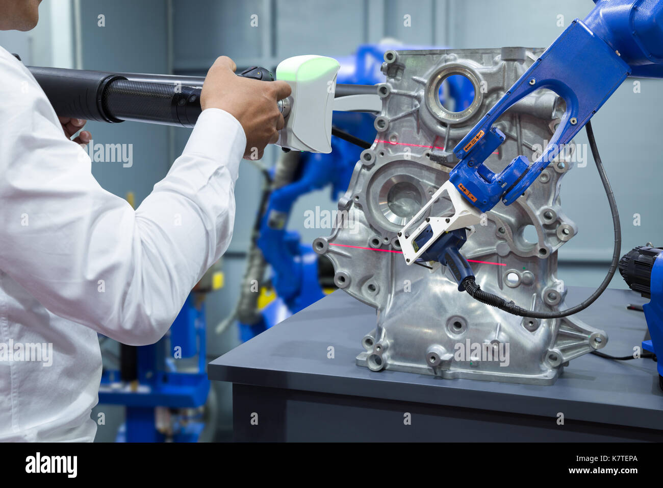 Engineer and assistant robot working with 3D portable measuring scan automotive part in factory, Industry 4.0 concept Stock Photo