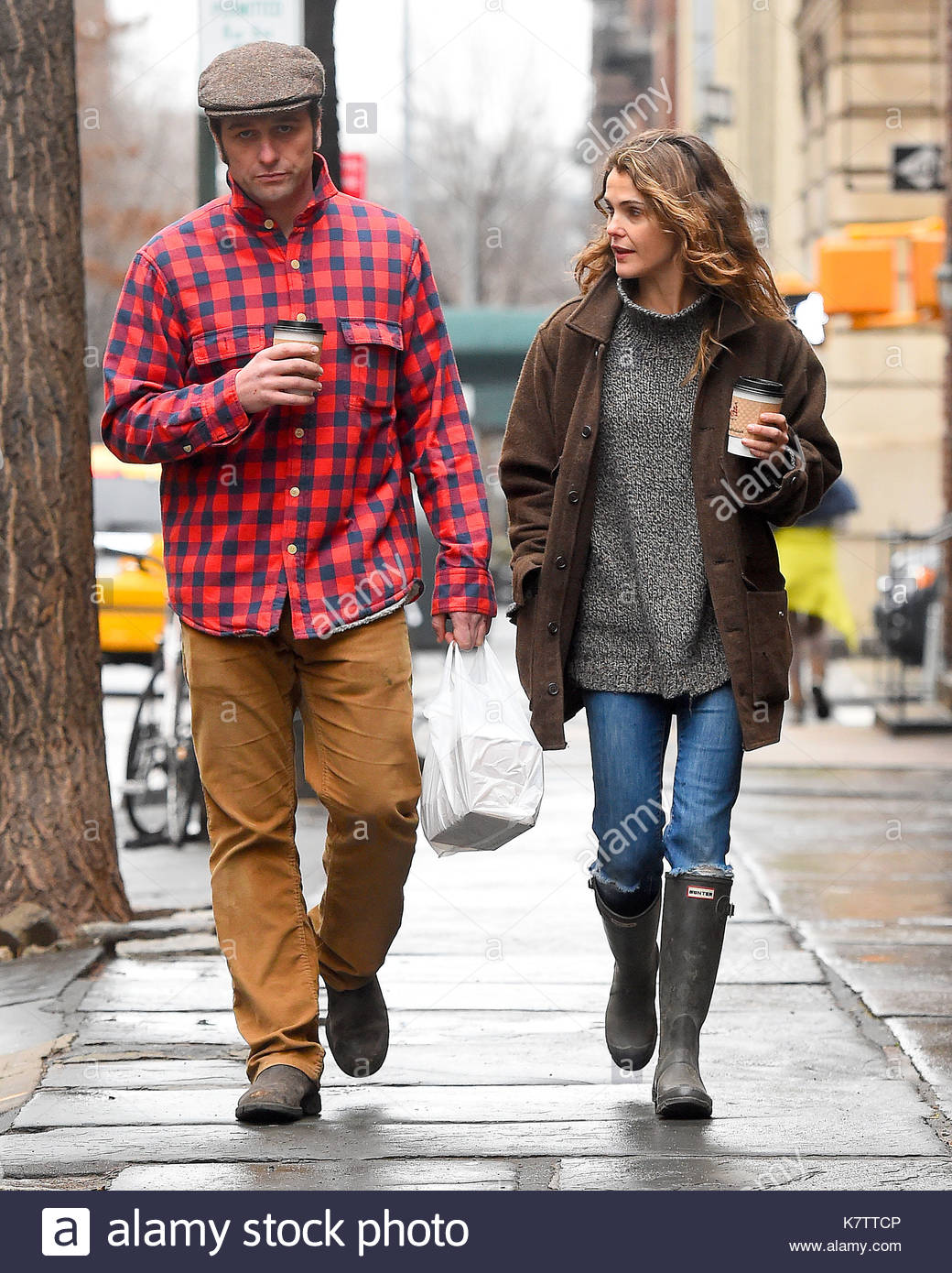 keri russell and matthew rhys. keri russell, wearing hunter boots
