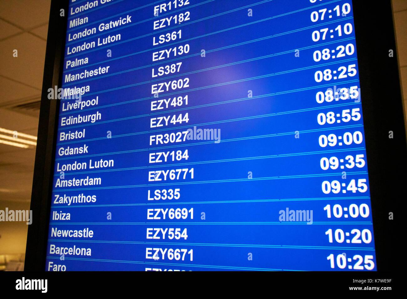Airport Flight Information Screen Showing Destinations Low