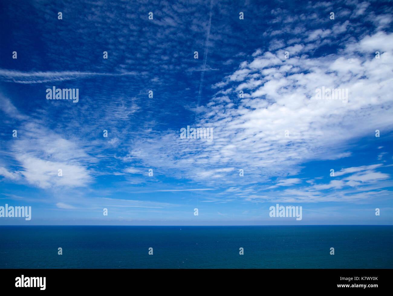 mackerel sky over calm ocean natural background Stock Photo