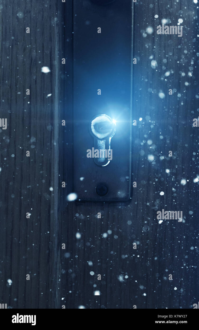 Door lock in snow fall and frost with blue light - Stock Image