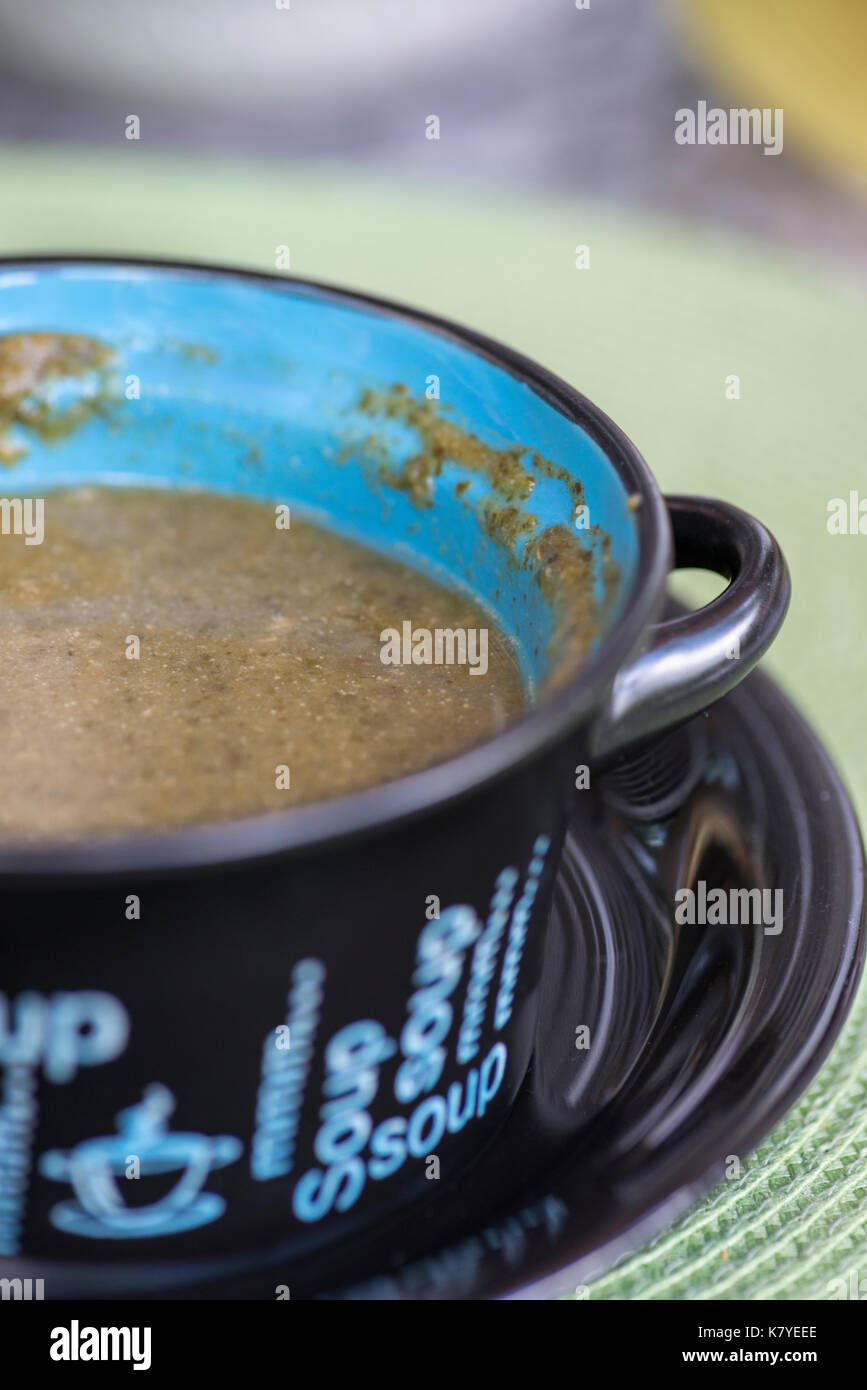 Callaloo soup served on a bowl. Green vegetable stew, staple food in the Caribbean, including Trinidad and Tobago. Served hot and spicy as starters or - Stock Image