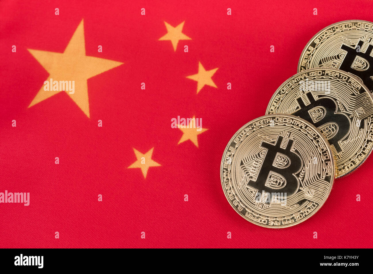 Chinese flag with BitCoin - after Chinese government expressed possiblity of banning or regulation BitCoin. China Blockchain conference concept. - Stock Image