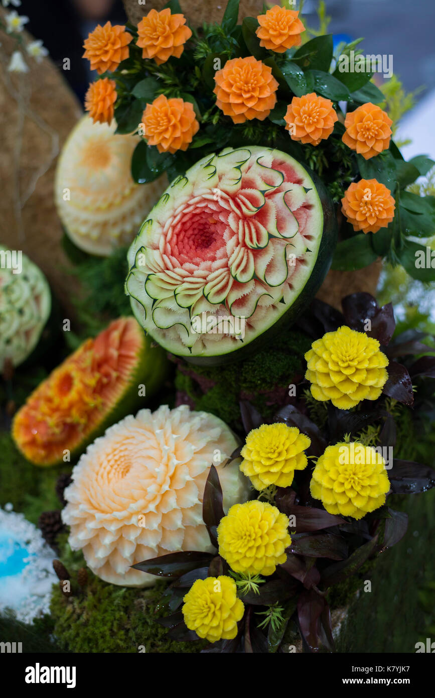 Thai fruit carving is a traditional Thai art that requires neatness, precision, meditation, and personal ability. Fruit carving persisted in Thailand  - Stock Image