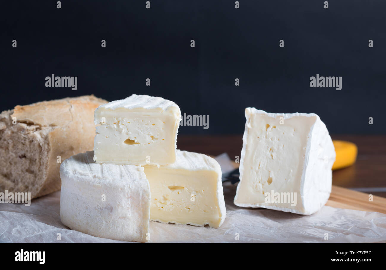 cheese on table with wine and bread - Stock Image