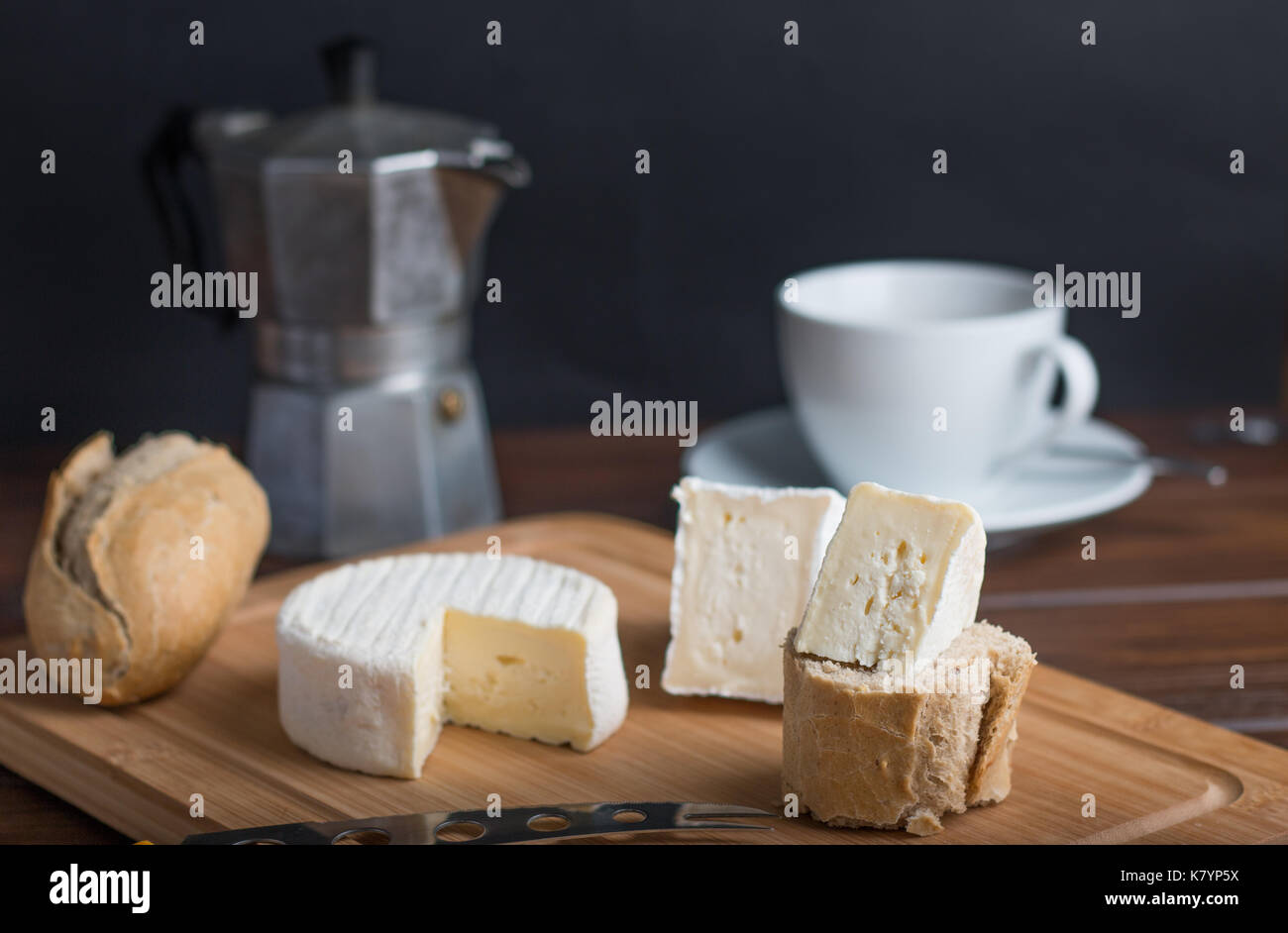 cheese on table with wine and bread and coffee - Stock Image