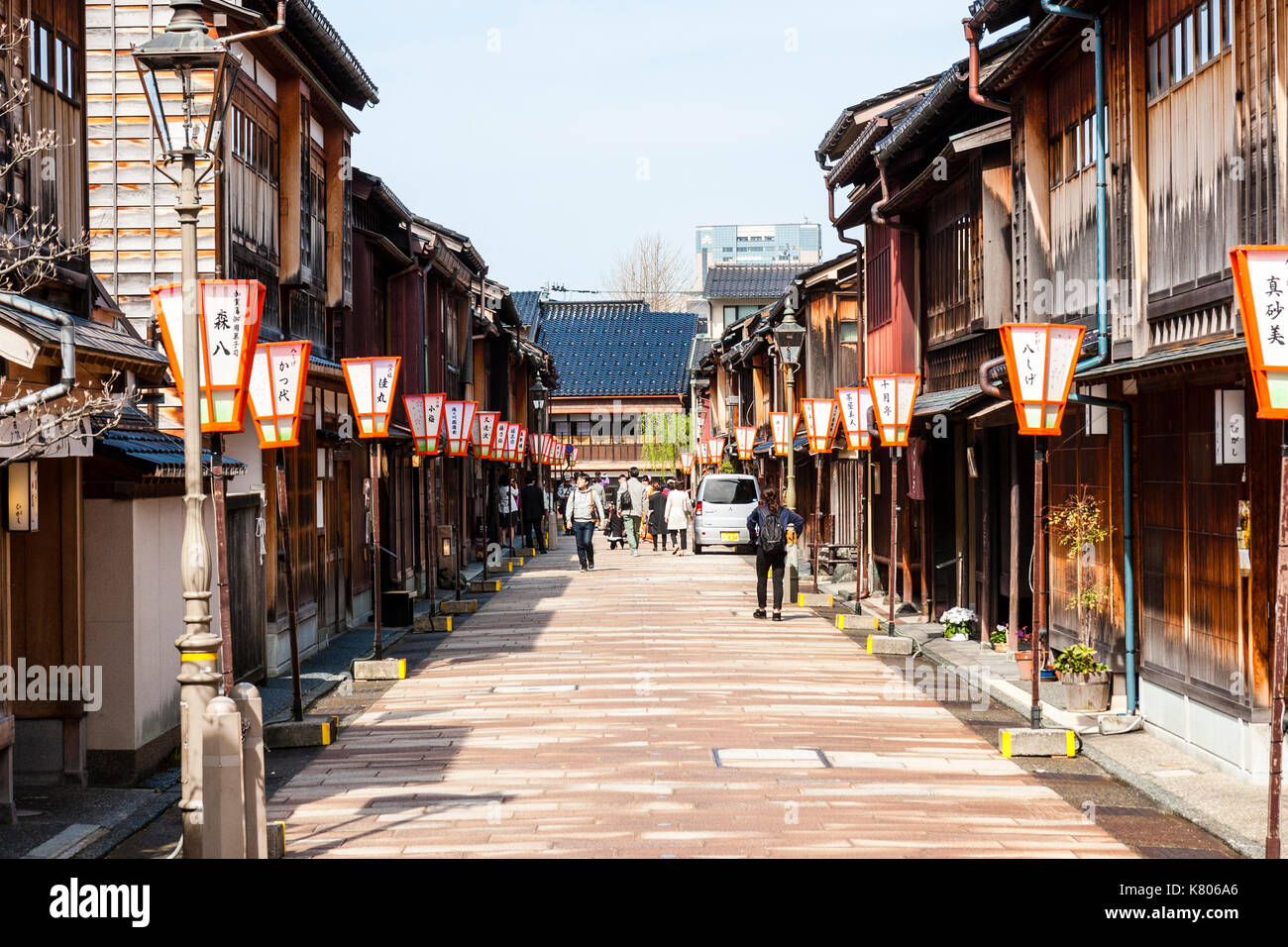Popular tourist destination, Higashi Chaya district in Kanazawa. Street lined on both sides with Edo period wooden buildings, ryokan, shops and inns. - Stock Image