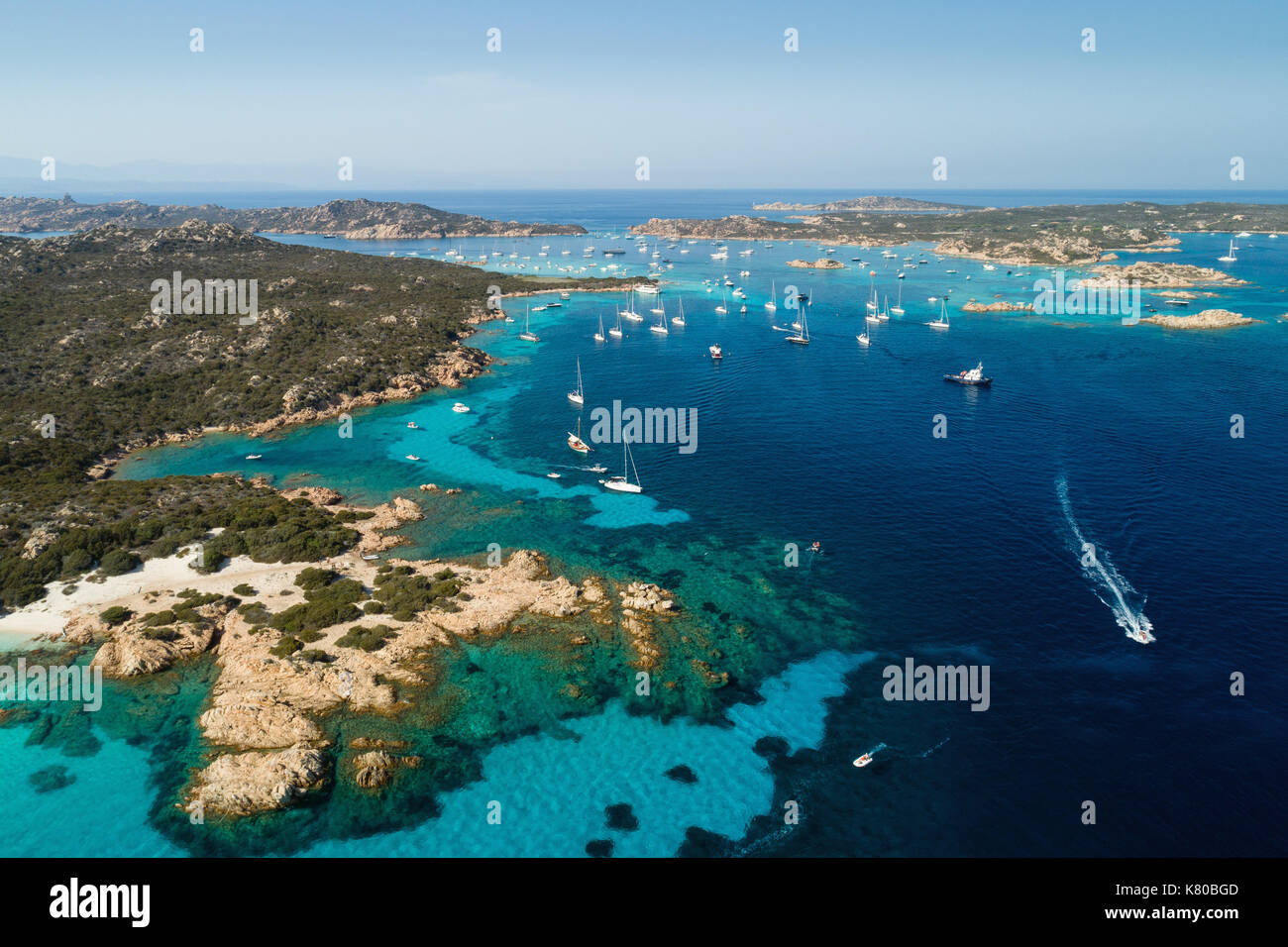 Aerial view of sailing yachts anchored near islands between Sardinia and Corsica - Stock Image