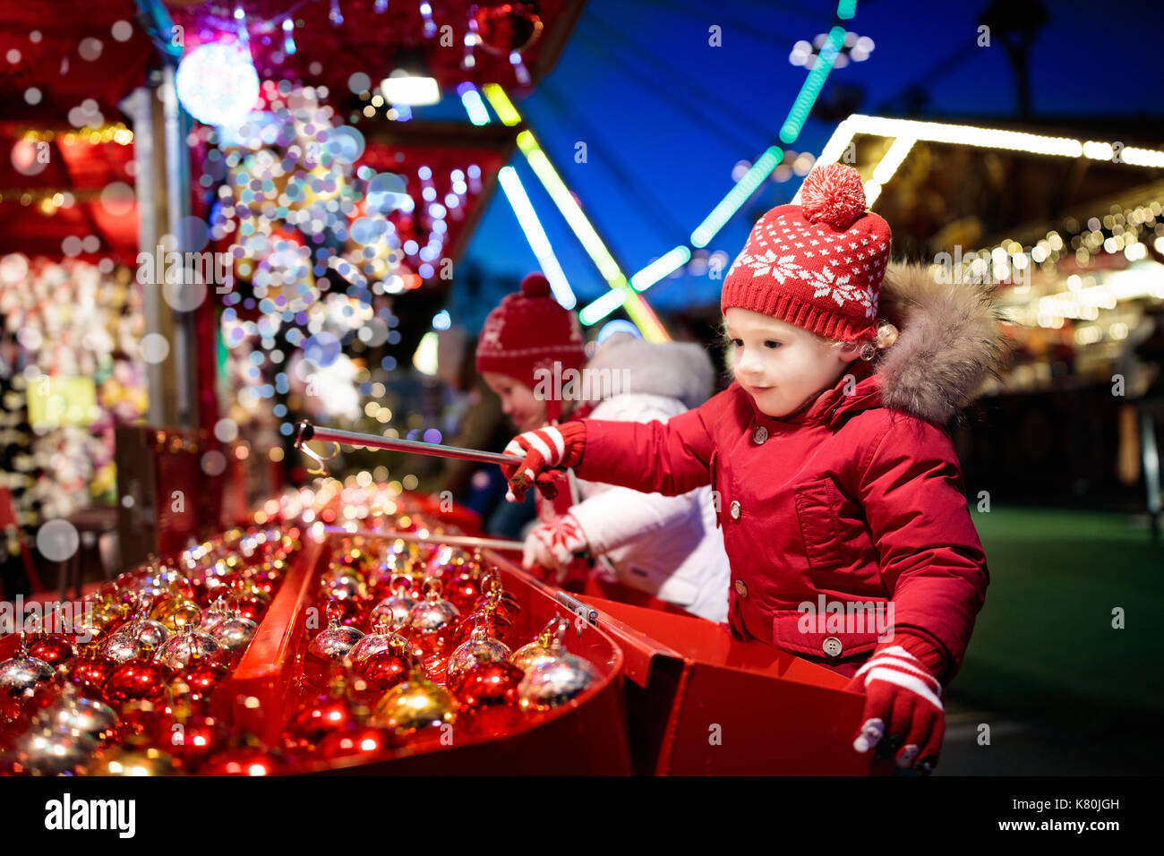 Kids at traditional Christmas fair. Children and Xmas market on snowy evening. Family shopping Christmas gifts and presents. Boy and girl play hook a  sc 1 st  Alamy & Kids at traditional Christmas fair. Children and Xmas market on ...