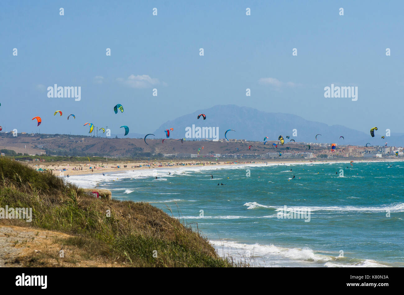 Kitesurfers and windsurfers on the beach at Ensenada de Bolonia, Costa de la Luz, Tarifa, Spain Stock Photo