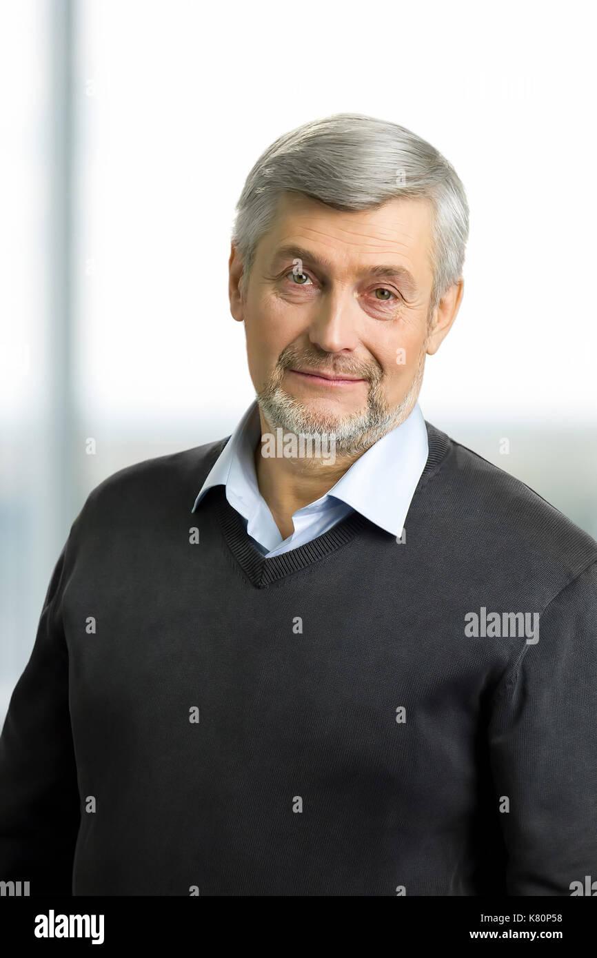 Portrait of grey hair man. Stock Photo