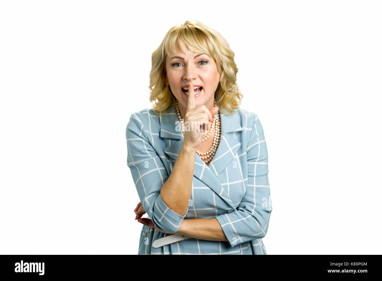 Happy mid adult female gesturing silence. - Stock Image