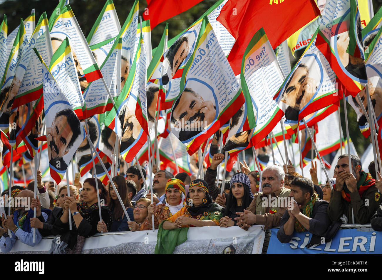 Cologne, Germany. 16th Sep, 2017. Participants of the international Kurdish culture festival wave flags showing Öcalan, the leader of the Kurdistan Workers' Party (PKK), at the Deutzer shipyard in Cologne, Germany, 16 September 2017. Turkey ordered the German ambassador in Ankara to the Foreign Ministry protesting against the Kurdish festival in Cologne. Photo: Christoph Hardt/Geisler-Fotopres/Geisler-Fotopress/dpa/dpa/Alamy Live News - Stock Image