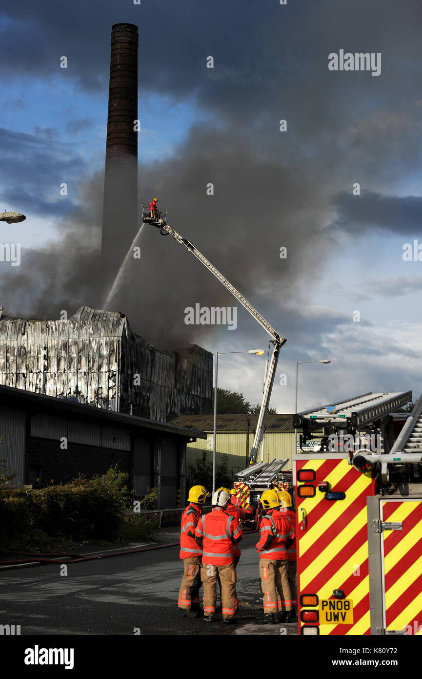 Bolton, UK. 17th September, 2017. Dozens of fire fighters tackle a huge blaze at the Viridor recycling plant on the Raikes Lane Industrial Estate, Bolton. No one is believed to have been seriously injured in the incident. Picture by Paul Heyes, Sunday September 17, 2017. Credit: Paul Heyes/Alamy Live News - Stock Image