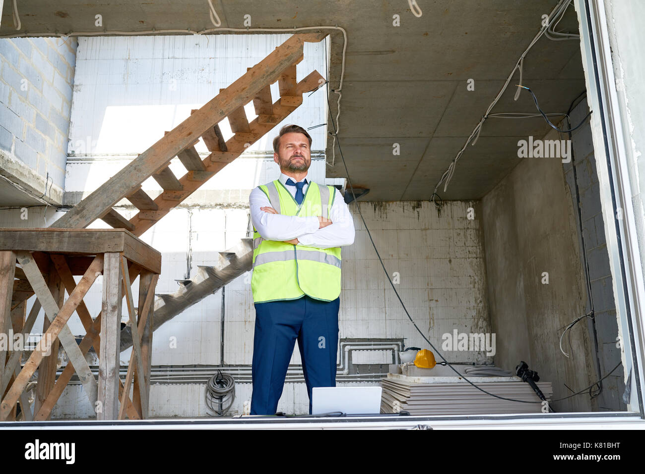 Bearded Businessman at Construction Site - Stock Image