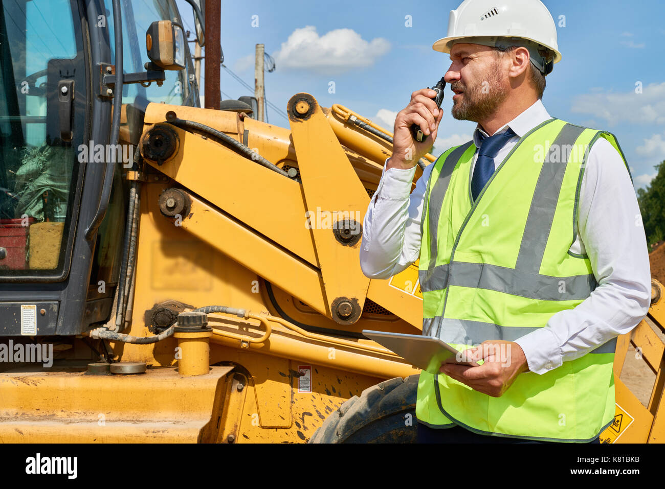 Busy Construction Worker in Suit - Stock Image