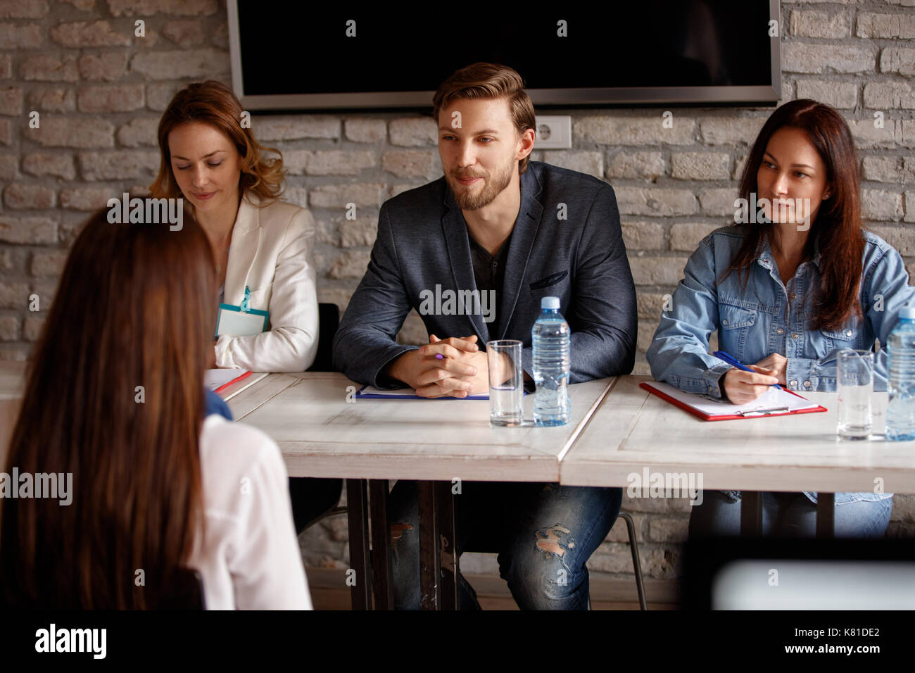 Three members commission talking with candidate for job - Stock Image