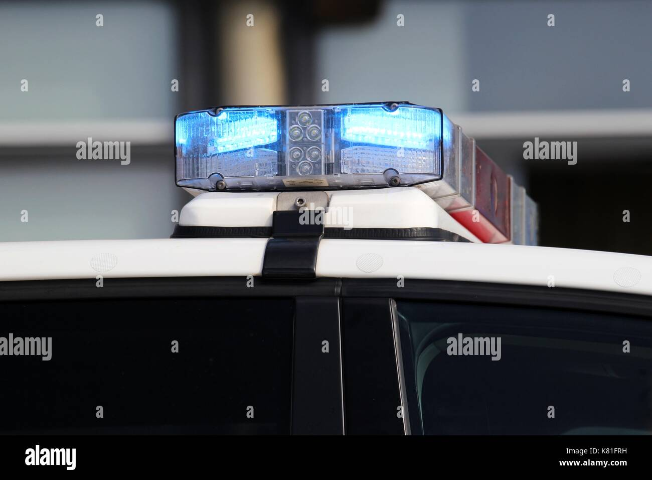 police car with active blue emergency vehicle lighting Stock Photo