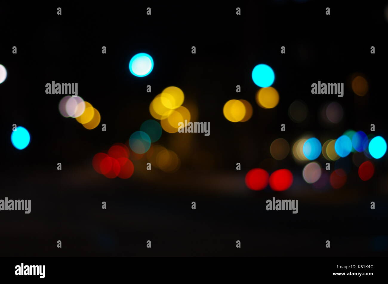 Night city lights bokeh background. Defocused bokeh lights. Blurred bokeh. Bokeh light background. Abstract colorful. Stock Photo
