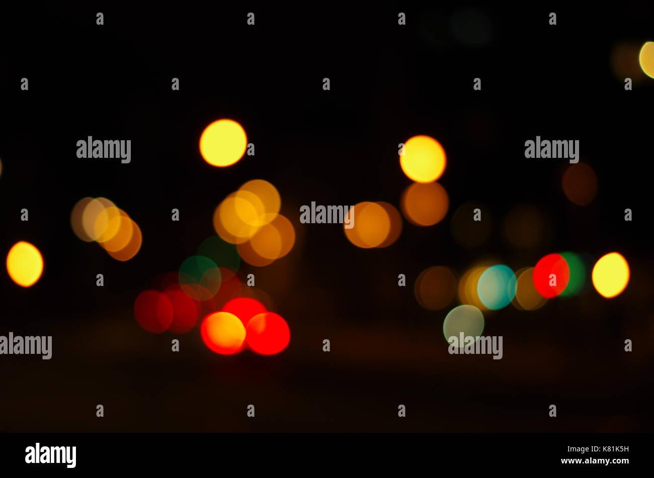 Night city lights bokeh background. Defocused bokeh lights. Blurred bokeh. Bokeh light background. Abstract colorful. Stock Photo