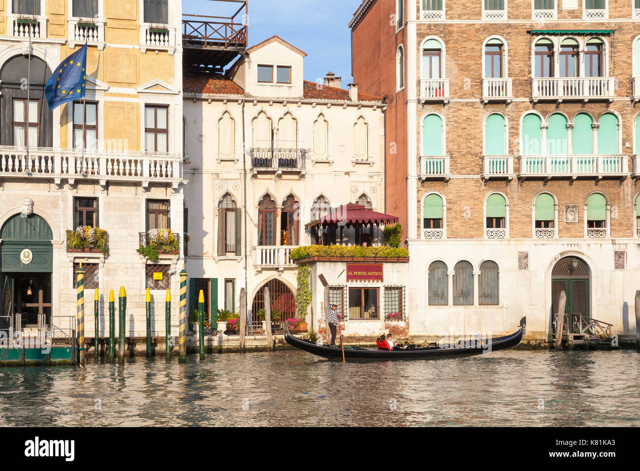 Romantic tour on the Grand Canal in a gondola in evening light, Venice, Italy in front of the Al Ponte Antico hotel in Cannaregio - Stock Image
