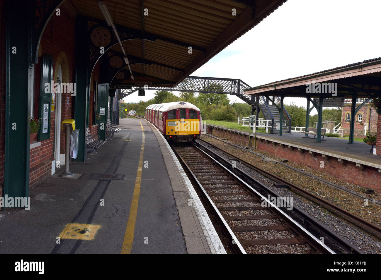 An island line main line railway train on the Isle of Wight uk using an old bakerloo line undergound train at brading Stock Photo