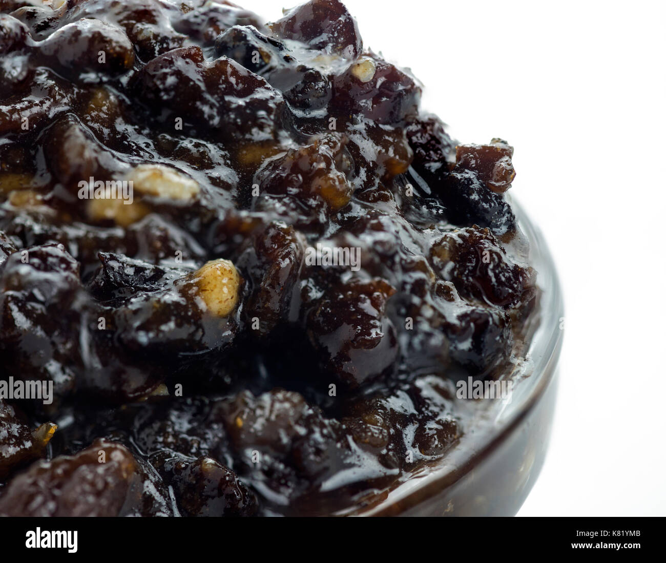 extreme macro shot of homemade Christmas traditional mincemeat home made with mixed fruits and brandy  in a glass Stock Photo