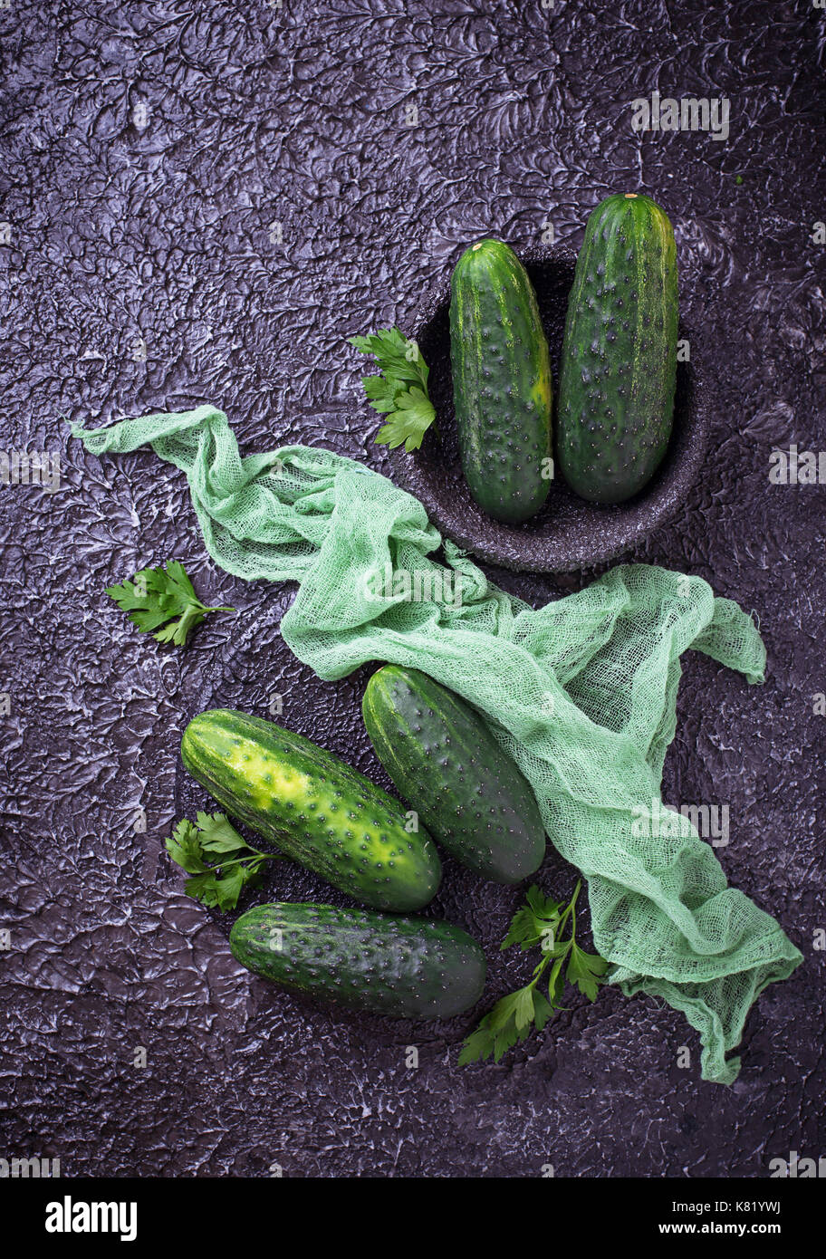 Fresh cucumbers on concrete background - Stock Image