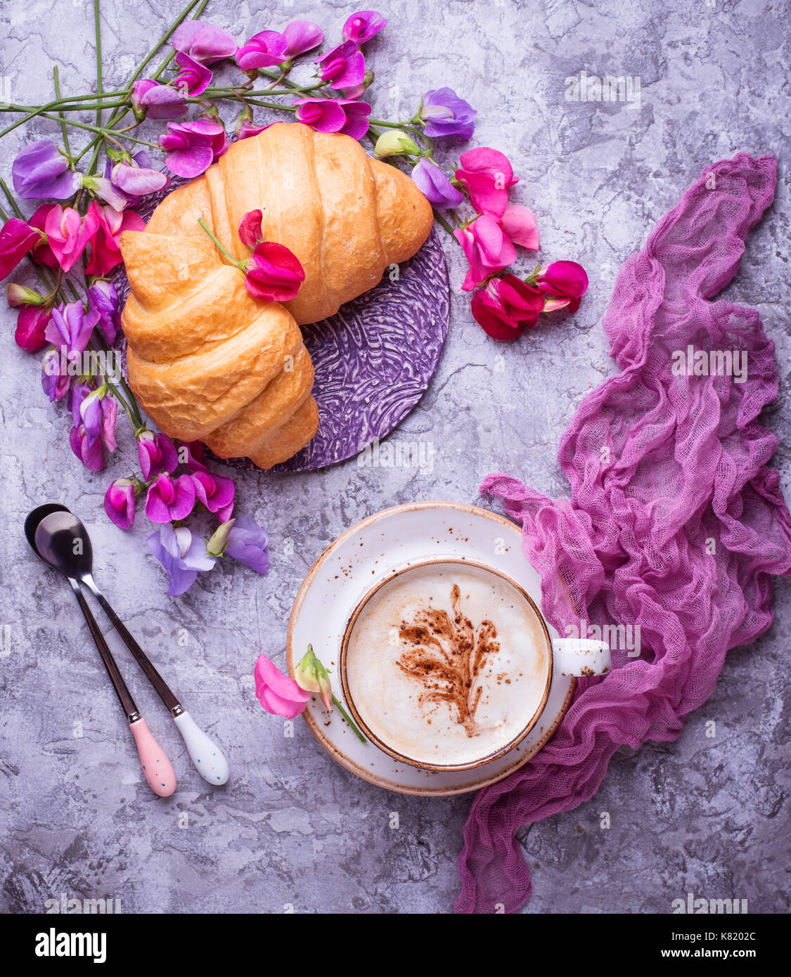 Coffee, croissants and flower.  - Stock Image
