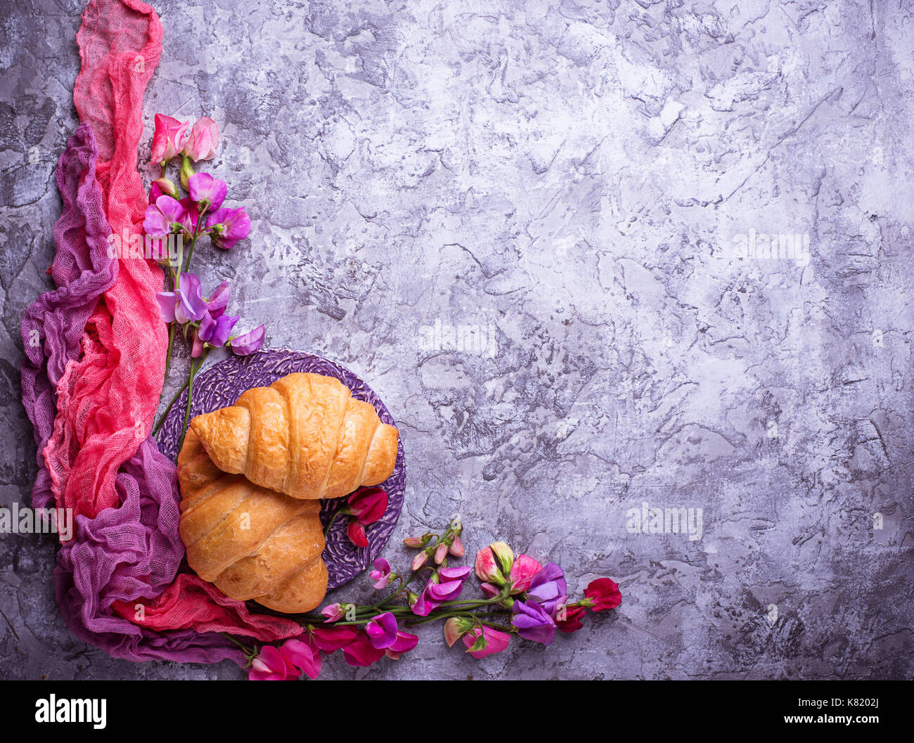 Croissants and flowers - Stock Image