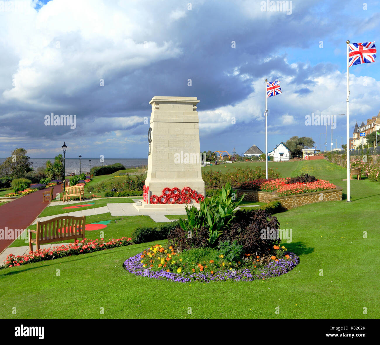 War Memorial, memorials, wreaths, poppies, Union Jack Flag, Flags, Remembrance, Esplanade Gardens, Union Jack Flags, Hunstanton, Norfolk, England, UK - Stock Image