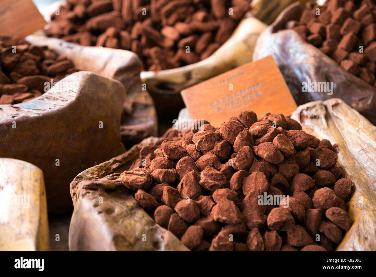 Cocoa dusted truffles on display in wooden bowls (Dark Sugars Cocoa House, London, UK) - Stock Image
